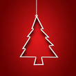Paper cut to form christmas tree on red background