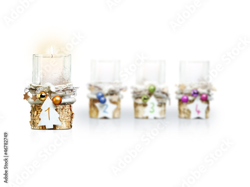 First Advent Candle on white background
