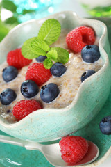 Oatmeal with fresh blueberries and raspberries.