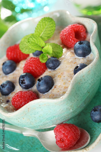 Oatmeal with fresh blueberries and raspberries.