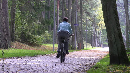 Active woman riding a bike in the park