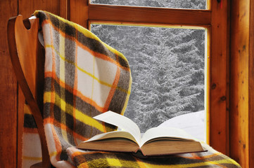 Book on a chair in winter