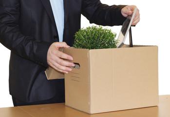 Jobless employee pack his personal belongings