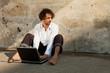 boy write on a laptop