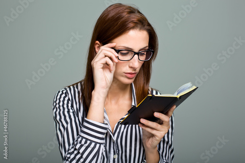 Smart Serious Woman Reading a Diary