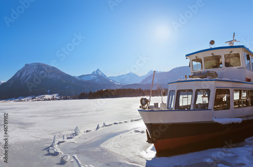 Ship in ice - village St Wolfgang on the lake Wolfgangsee - Aust