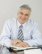 Smiling senior businessman in office