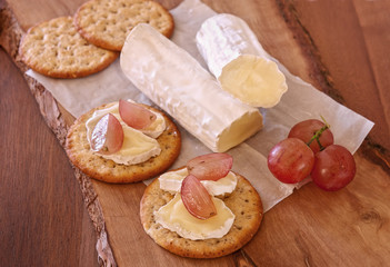 Brie cheese with grape and crackers