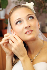 bride wears jewelry