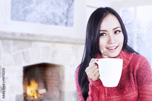 Attractive young woman enjoy coffee at home