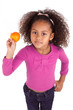 Little African Asian girl holding a tangerine ,isolated on white