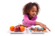 Little African Asian girl hesitating between fruits or  candy