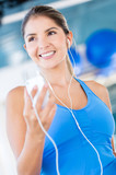 Gym woman listening to music