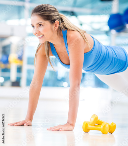 Gym woman doing push ups
