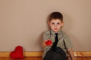 Little Boy Holding a read Heart