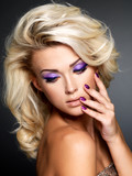 Fototapety Beautiful woman with beauty purple manicure and makeup of eyes.