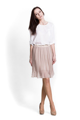 Beautifull woman in beige skirt
