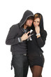 Young couple in hoods looking with conspiracy