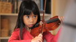 Six Year Old Asian Girl Practices Her Violin