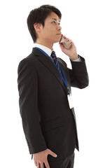young businessman is talking on a mobile phone