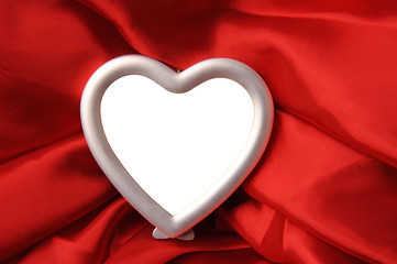 hearts copyspace photo frame on red silk