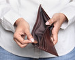 Person taking a penny from wallet - Bankruptcy