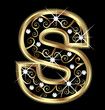 S gold letter with swirly ornaments