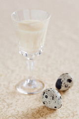 Egg liqueur and quail eggs. Selective focus