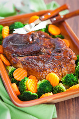 Honey glazed roast pork, carrots and broccoli. Selective focus