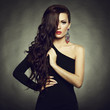 Portrait of beautiful brunette woman in black dress