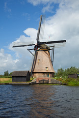 Windmill in Kinderdijk against Blue Sky