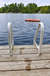 Footprints on dock at summer lake