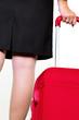 Geschäftsfrau mit Handgepäck