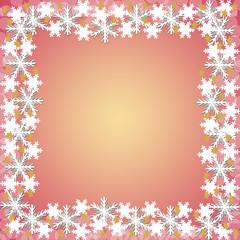 オレンジ色の背景と雪の結晶のフレーム
