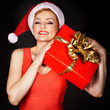 woman wearing santa hat  holding  Christmas gift