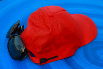 Red Hat sunglasses blue background