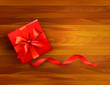 Holiday background with gift box and red bow.