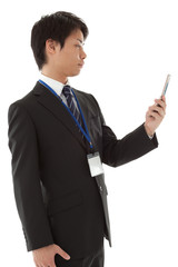 Young businessman working with mobile phone