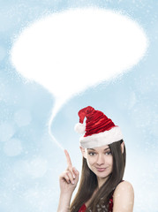Young woman as funny christmas elf with blank space above