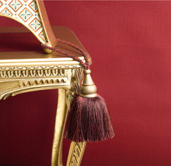 cute design of tassel on the golden chair
