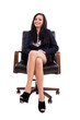 Beautiful businesswoman sitting on an armchair isolated on white