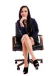 Beautiful businesswoman thinking while sitting on an armchair is