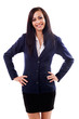 Latin businesswoman standing with hands on hips