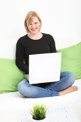 Woman using a laptop in her living room