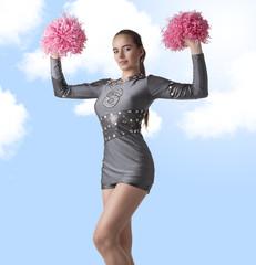 sexy cheerleader raises pompom