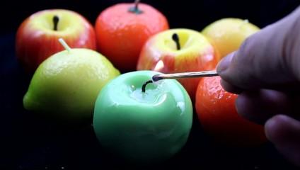 burning apple candle