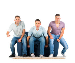 Young men sitting on a sofa, Anticipation
