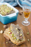 Slice of bread with chicken liver pate with pistachios