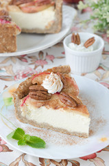 slice of cheesecake with apples and caramelized pecans vertical
