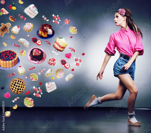 Escape. Running woman refuses to eating tasty cakes. Dieting